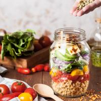 Lentil salad with fried cheese in a jar